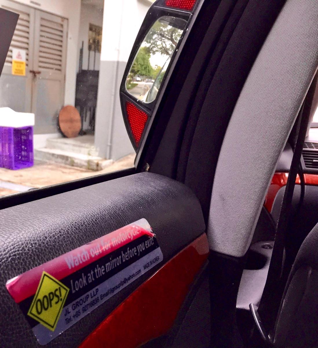 Singapore taxi mirror