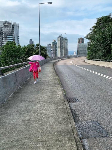woman with umbrella in HK